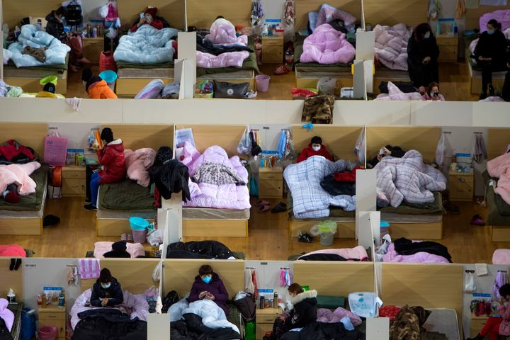 Patients infected with the coronavirus take rest at a temporary hospital converted from the Wuhan Sports Center in Wuhan in c