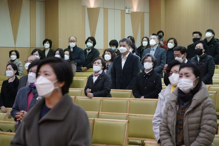 Christian faithful wearing masks to prevent contacting coronavirus pray during a service in Seoul, South Korea, February 23,