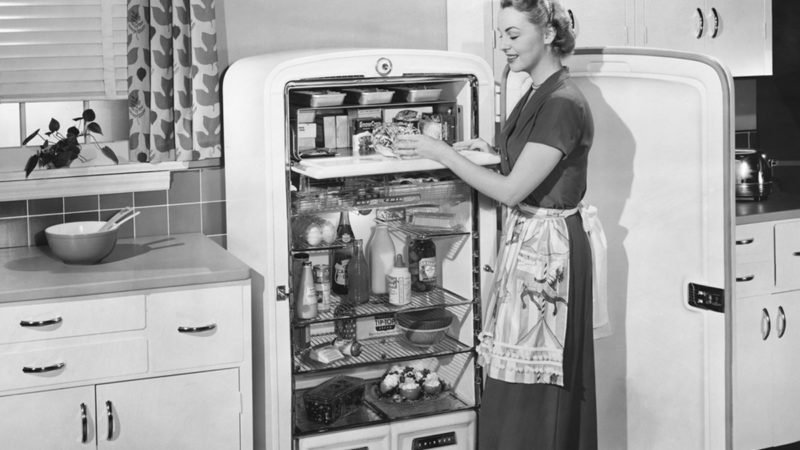 Woman with open refrigerator