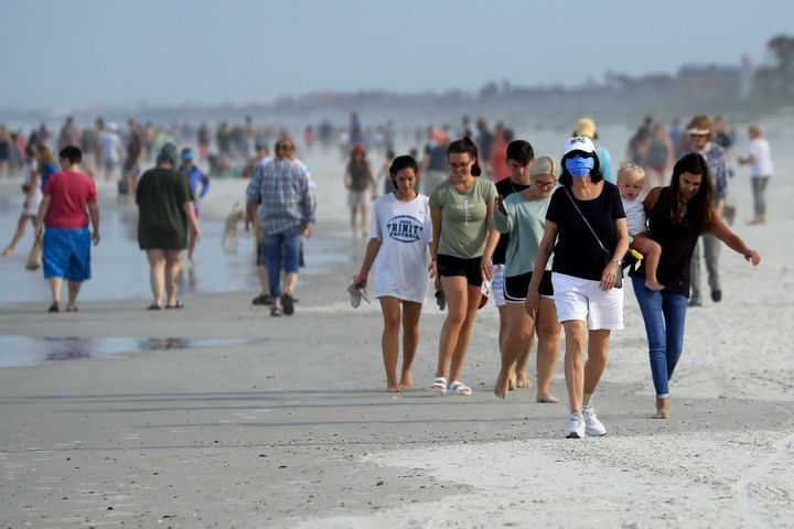 People flock to newly opened beach in Jacksonville Beach, Florida.
