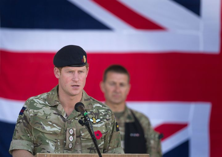 Prince Harry speaks at a Remembrance Sunday service at Kandahar Airfield Nov. 9, 2014, in Kandahar, Afghanistan. Harry served