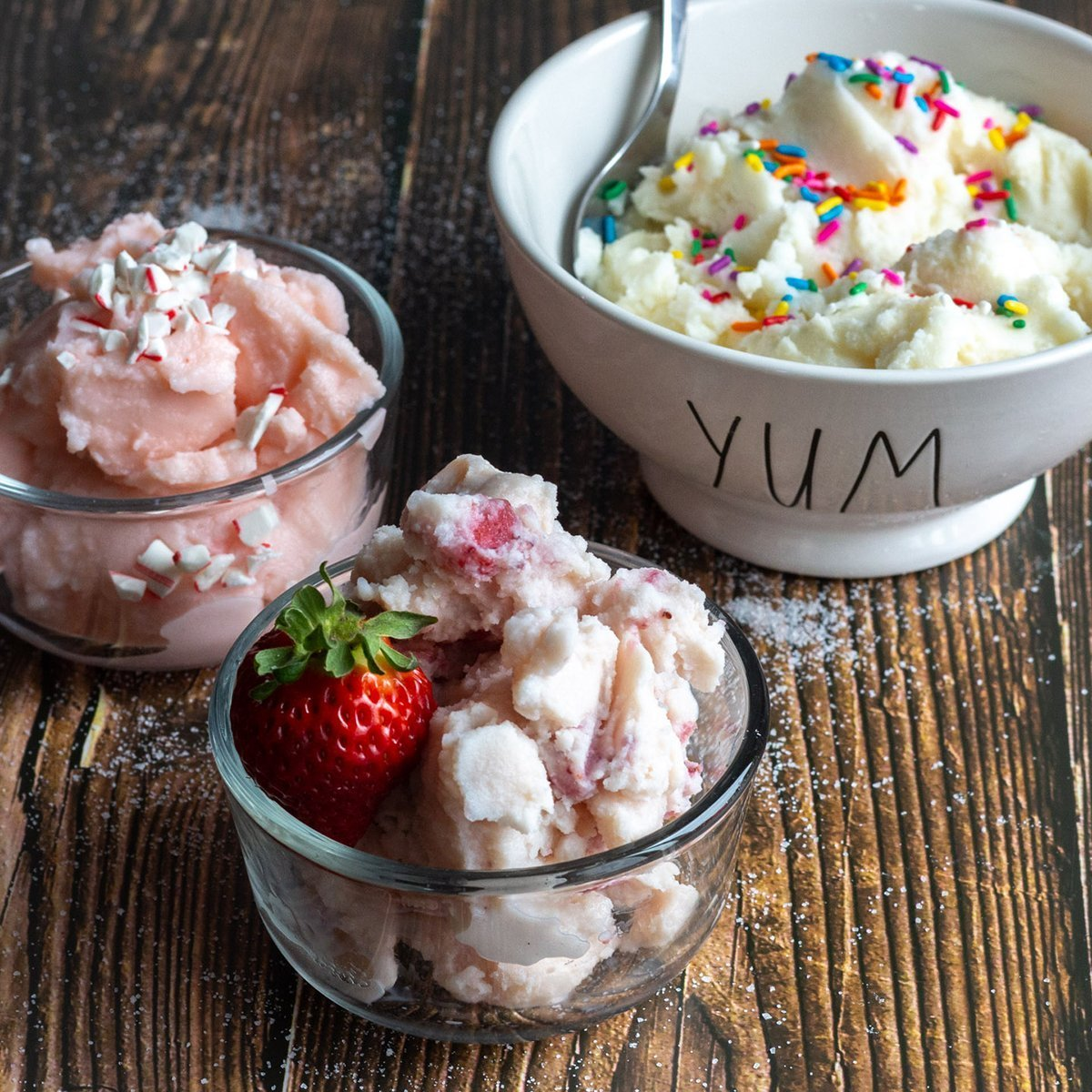 Ice cream, three kinds in dishes.