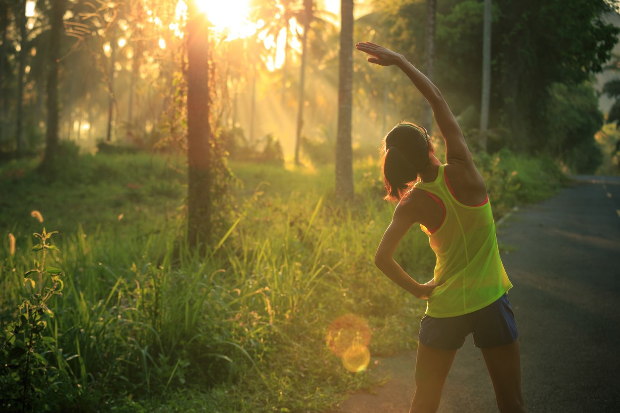 Woman-exercising-in-sunshine-forest.jpg