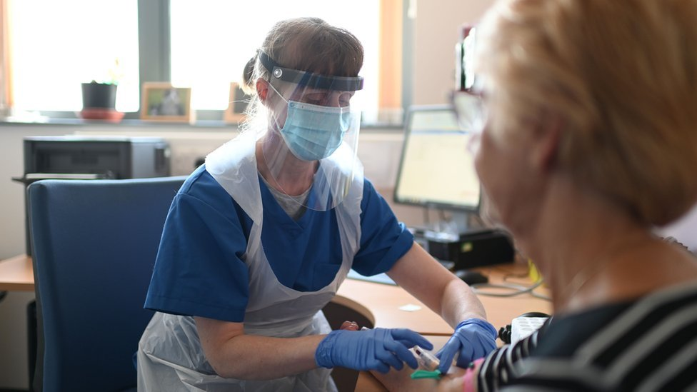 A nurse wears personal protective equipment