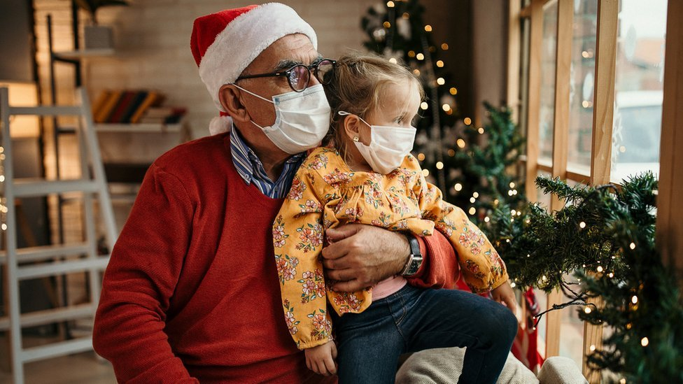Grandfather sits with granddaughter during festive period