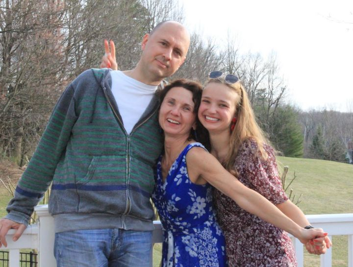 The author (right) with her parents in early March, on her mother's birthday.