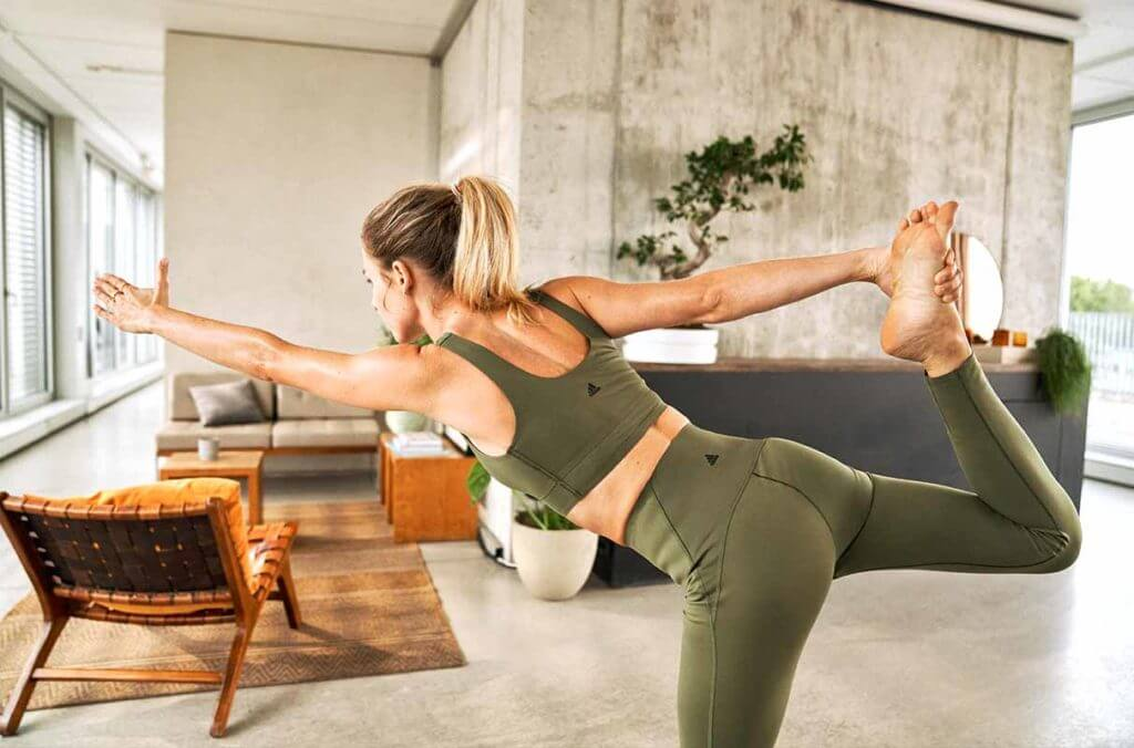 A woman is doing yoga as it helps to listen to the body