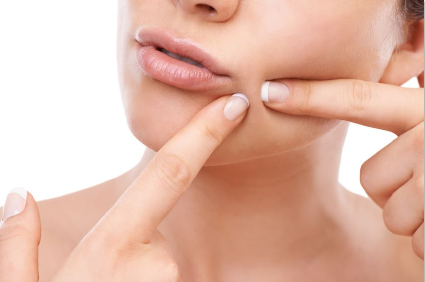 woman checking skin winter skincare itchy skin