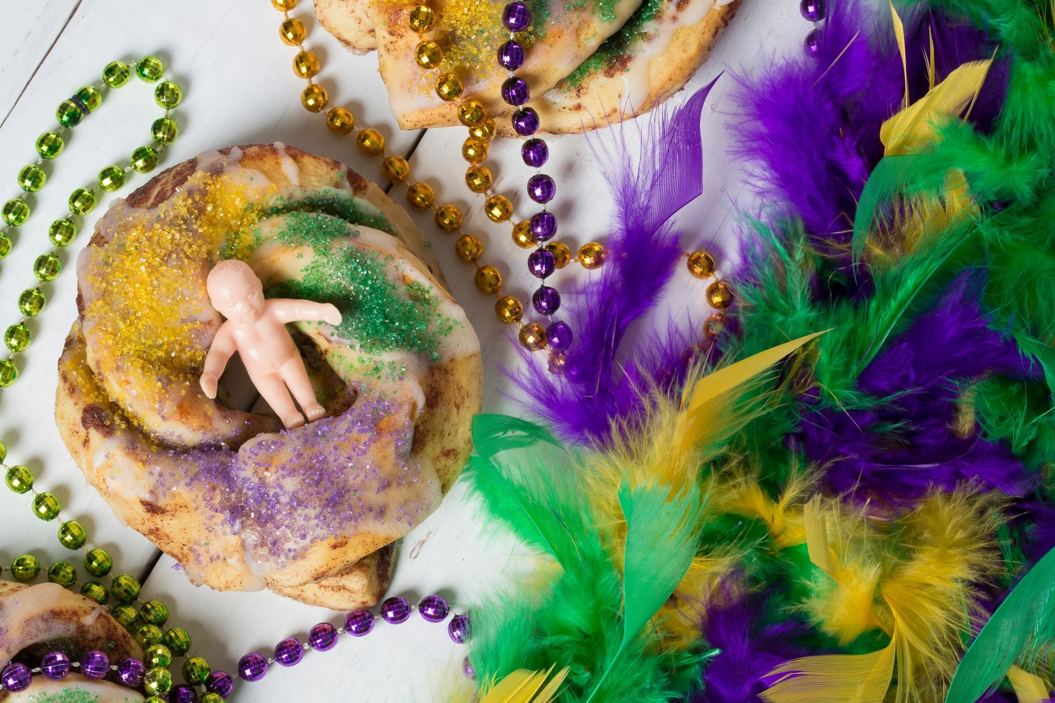 Mardi Gras King Cakes, Beads, and Baby