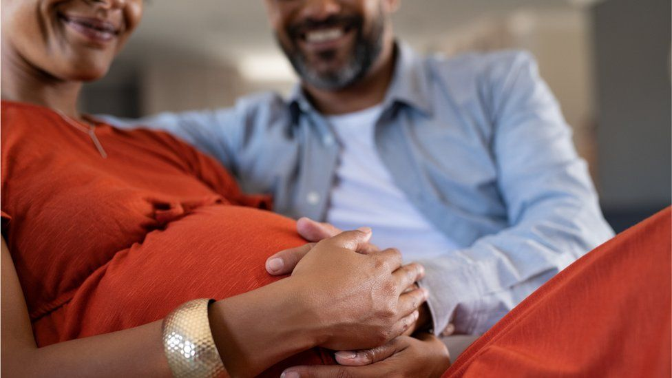 Pregnant woman and male partner