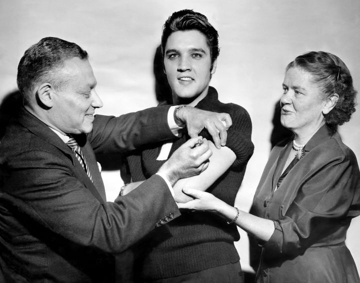 In 1956, Elvis Presley received a polio vaccination from Dr. Leona Baumgartner and Dr. Harold Fuerst in New York.
