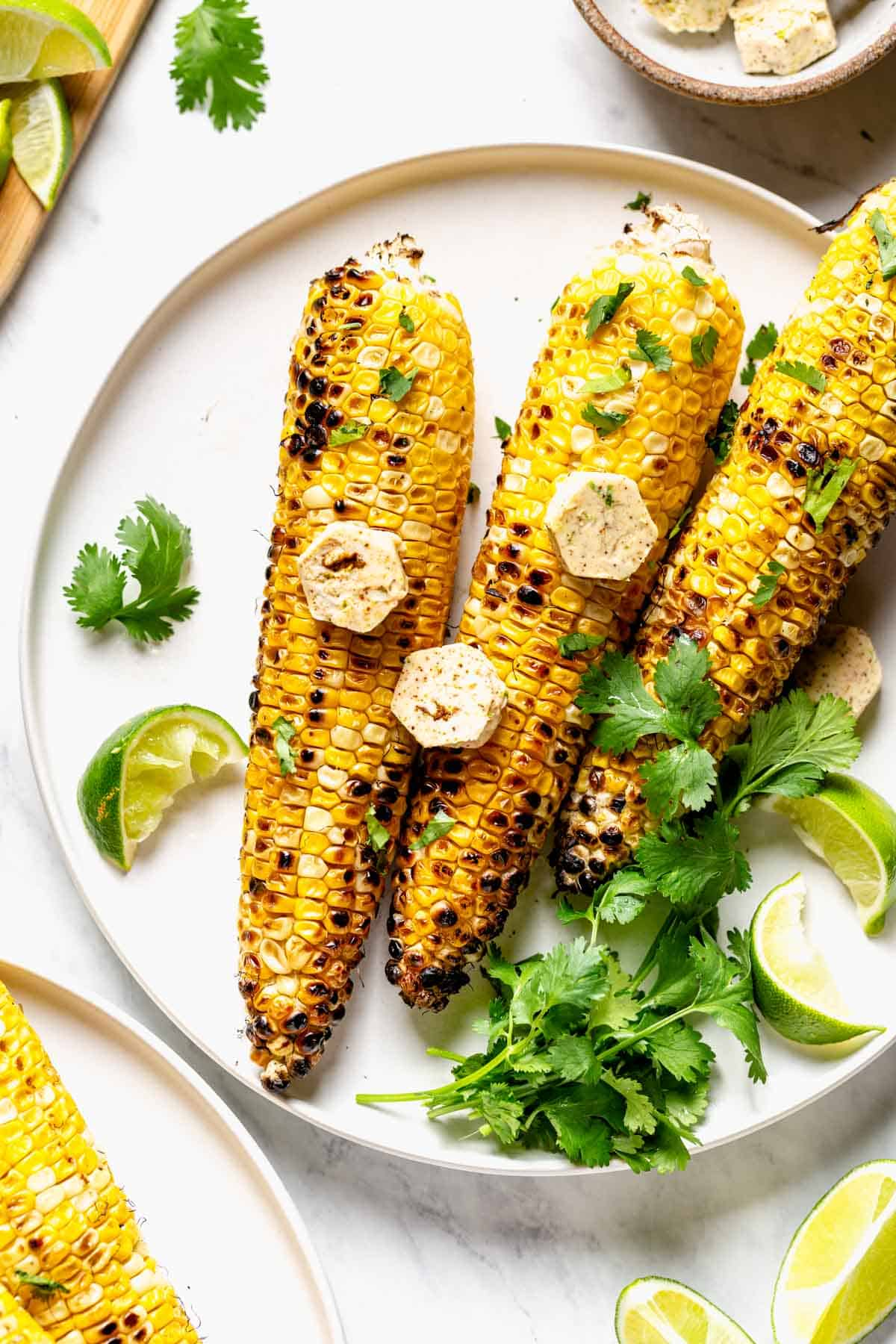 Grilled Corn with compound butter on it