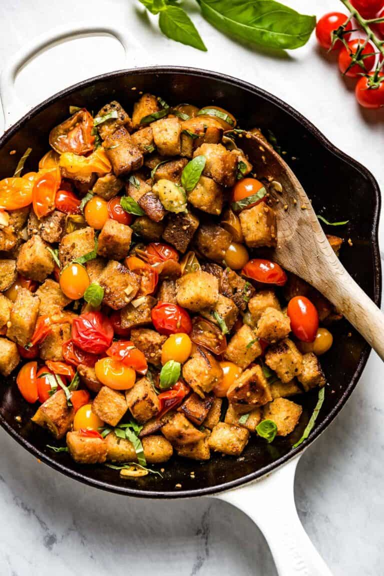 the skillet with the panzanella in it up close