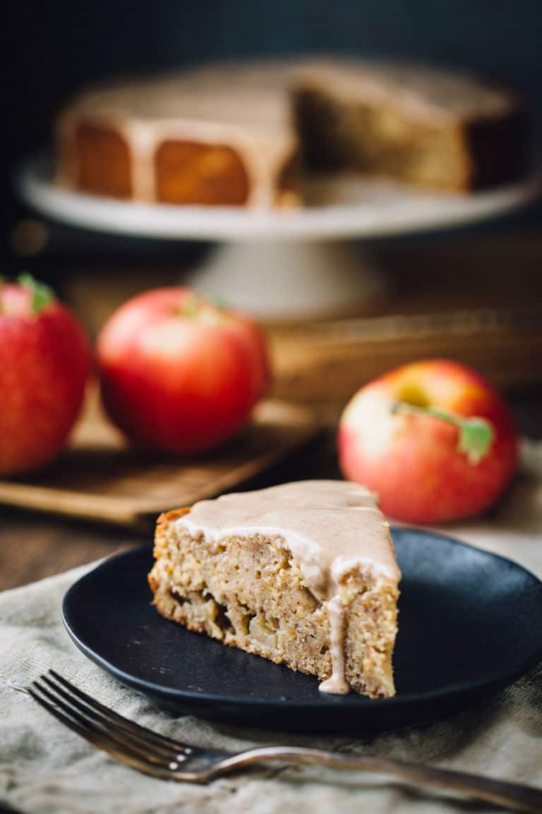 a black plate with Apple Cake