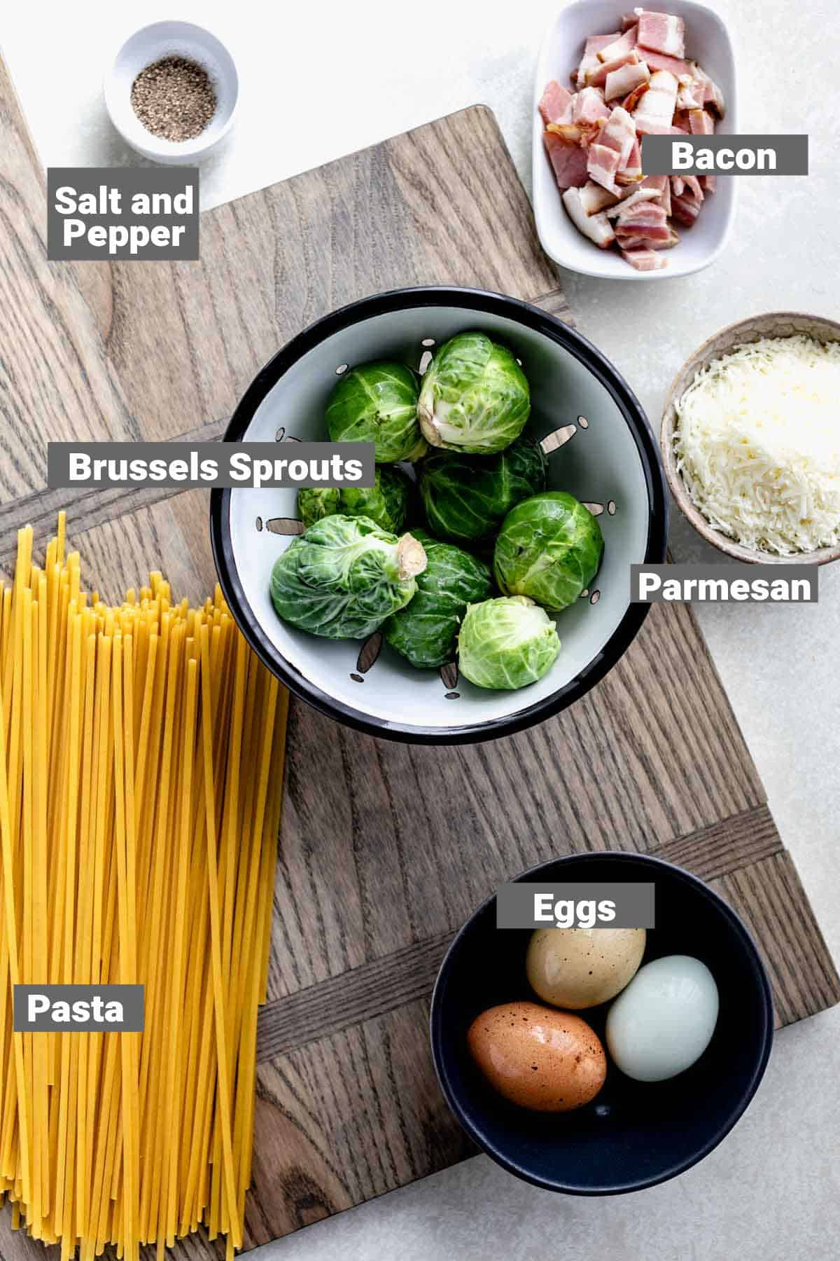brussels sprouts, linguini and other ingredients for this recipe with text overlay