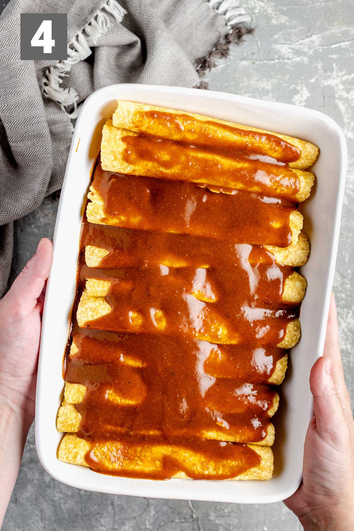 the enchiladas with sauce on them before they are baked